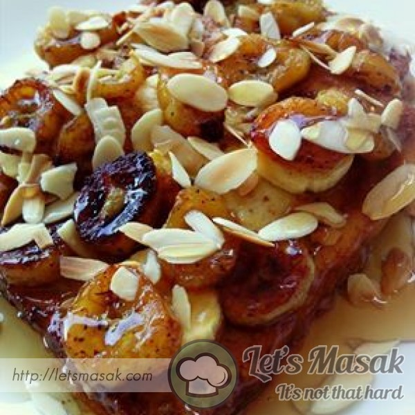 French Toast With Caramelized Bananas And Toasted Almonds