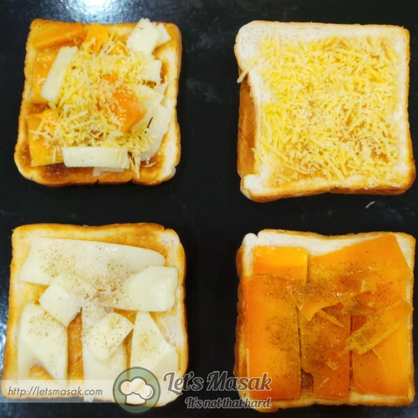 Put the cheeses on the toasts. One of the toast, mix all the cheeses on it. Spread black pepper on each of them.